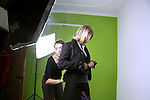 Fashion designer arranging model during photo shoot