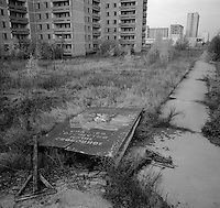 """Chernobyl, Ukraine, Ocober 1995..The explosion at the Chernobyl Nuclear Power Plant on April 26 1986 was the worst nuclear accident in history..The city of Pripyat, within sight of the power plant, and formerly the home of Chernobyl staff and thousands of others, lies deserted. The fallen sign reads """"Glory to our free Motherland""""."""