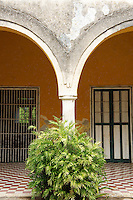 Arches in patio of main building at Hacienda Yaxcopoil, Yucatan, Mexico.