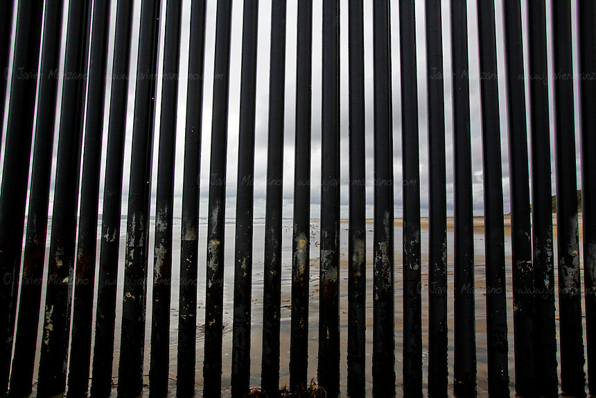 "The ""Parque Fronterizo de la amistad"", or the ""border friendship park"" is a place where families from both sides od the border meet their relatives to talk, meet new family members, and often hold hands in between the steel columns that separate both countries. Tijuana, Baja California, Mexico - February 8, 2013.  (Javier Manzano / For The Washington Post)."