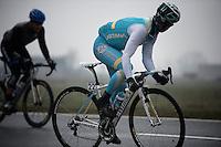 Dwars Door Vlaanderen 2013.Assan Bazayev (KAZ) trying an acceleration