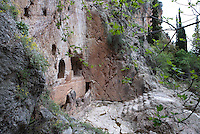 DELPHI, GREECE - APRIL 11 : A general side view of the Castalian Fountain at the foot of the rocky crag Phleboukos (ancient Hyampeia), Delphi, Greece. The Castalian Fountain was built circa 590-600 BC. It was the sacred source of Delphi, having an essential role in the cult and the oracle. This is where the Pythia, the priests and the theopropoi (prophets) washed to purify themselves. (Photo by Manuel Cohen)