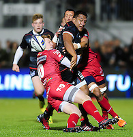 Mako Vunipola of Saracens offloads the ball after being double-tackled. European Rugby Champions Cup match, between Saracens and the Scarlets on October 22, 2016 at Allianz Park in London, England. Photo by: Patrick Khachfe / JMP