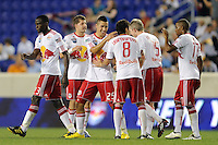 Connor Chinn (25) of the New York Red Bulls celebrates scoring with teammates. The New York Red Bulls defeated the Colorado Rapids 3-0 during a U. S. Open qualifier match at Red Bull Arena in Harrison, NJ, on May 26, 2010.