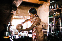 Jaya, sister of Sanju, carefully prepares chai at home.  Her Dalit community lives in isolation from the 'higher' castes.  Segregation has been one of the keys to preserving the caste system from generation to generation.<br />