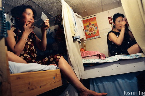 France, Paris, 05-2003..Clandestine Chinese immigrants work as prostitutes in Paris. The woman on the left pays her son's art college fees in China. ..They are a new wave of immigrants from China?s northeast, home to millions of former cradle-to-grave factory workers laid off by closures. ..