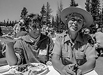 "Tuolumne Meadows, August 24, 1985:  Barbra DeWitt and Ann Mendershausen.  Mount Ansel Adams, an 11,700 foot peak in a remote section of Yosemite National Park was dedicated Saturday, August 24, 1985, in a ceremony recognizing the famed photographer for his contribution to the American conservation movement. Adams was eulogized as a man who dedicated his life to photography and the preservation of planet Earth. The dedication ceremony was led by Adams' son, Dr. Michael Adams of Fresno, and attended by Adams' widow, Virginia Adams, Secretary of the Interior Donald Hodel, Sen. Alan Cranston, D-California, National Park Service Director William Penn Mott, actor Robert Redford, and other environmental and conservation leaders. In 1932, Ansel Adams and several Sierra Club companions first climbed the peak, according to Virginia Adams, who added that ""Ansel loved its tower shape. He called it 'The Tower' on the Lyell Fork of the Merced River. After they came down from climbing it, they sat around the campfire and one of them suggested that they name it Mount Ansel Adams."" Informally, that is what the Sierra Club did, calling the peak Mount Ansel Adams in the Sierra Club Guide until 53 years later the peak was finally officially named.  Photo by Al Golub/Golub Photography"