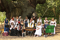 Meery minstrels play benaeath the Major Oak at the Robin Hood Festival whcih takes place in August at Sherwood Forest Visitor Centre, Edwinstowe, Nottinghamshire