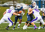 8 October 2016: Middlebury College Panther Running Back Diego Meritus, a Sophomore from Yarmouthport, MA, break away from Amherst College Defensive Lineman Paul Johnson, a Senior from Moorestown, NJ, at Alumni Stadium in Middlebury, Vermont. The Panthers edged out the Purple & While 27-26. Mandatory Credit: Ed Wolfstein Photo *** RAW (NEF) Image File Available ***