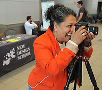 NWA Democrat-Gazette/ANDY SHUPE<br /> Sonia Gutierrez, founder and COO of New Design School in Fayetteville, photographs Brian Dodwell of Fayetteville Thursday, May 18, 2017, during Tech Fest  in the Fayetteville Town Center. New Design School currently operates out of a shared space with Startup Junkie on the square, but school officials hope to move to a permanent location on the first floor of the historic Walker-Stone House.