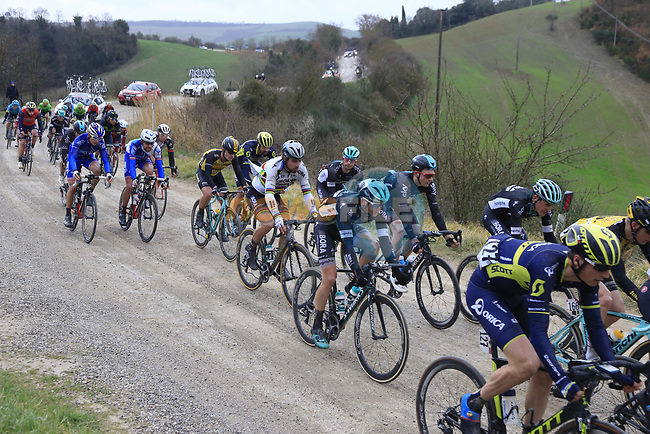 The peloton on gravel sector 6 Pieve a Salti during the 2017 Strade Bianche running 175km from Siena to Siena, Tuscany, Italy 4th March 2017.<br /> Picture: Eoin Clarke | Newsfile<br /> <br /> <br /> All photos usage must carry mandatory copyright credit (&copy; Newsfile | Eoin Clarke)
