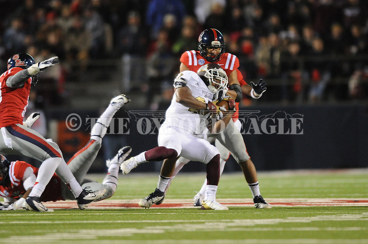 Ole Miss defensive back Cody Prewitt (25) tackles Mississippi State running back LaDarius Perkins (27) at Vaught Hemingway Stadium in Oxford, Miss. on Saturday, November 24, 2012. Ole Miss won 41-24.