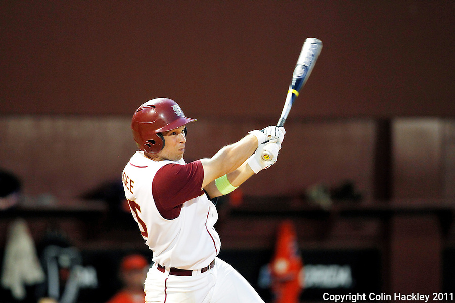 TALLAHASSEE, FL 5/20/11-FSU-CLEMBASE11 CH-Florida State's Mike McGee hits a home run in the eight inning against Clemson Friday at Dick Howser Stadium in Tallahassee. The Seminoles lost to the Tigers 4-7..COLIN HACKLEY PHOTO