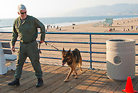 Beverly Hills K-9 Police Officer Finn McClafferty and his partner, Max, a five year-old German Shepherd, search the Santa Monica Pier during a weekly training session on Wednesday, December 14, 2011.