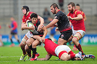 Gela Aprasidze of Georgia U20 is tackled. World Rugby U20 Championship match between Wales U20 and Georgia U20 on June 11, 2016 at the Manchester City Academy Stadium in Manchester, England. Photo by: Patrick Khachfe / Onside Images