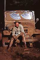 A man and his car stuck in the mud near Stampede Resevoir CA