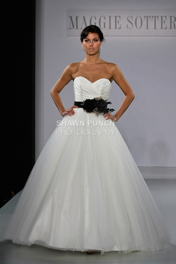 Model walks runway in an April wedding dress from the Maggie Sottero Spring 2013 collection, at The Couture Show, during New York Bridal Fashion Week, on October 14, 2012.