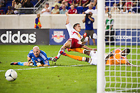 Connor Lade (16) of the New York Red Bulls goes airborne after knocking Macoumba Kandji (9) of the Houston Dynamo off the ball as he was shooting. The New York Red Bulls defeated the Houston Dynamo 2-0 during a Major League Soccer (MLS) match at Red Bull Arena in Harrison, NJ, on August 10, 2012.