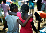 Two girls walk together during the weekly market in Despagne, an isolated village in southern Haiti where the Lutheran World Federation has been working with residents to improve their quality of life.