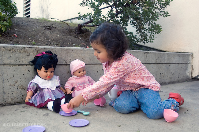 Berkeley CA Girl, two and a half, half Nepalese. having a tea party with her dolls MR
