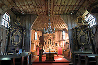 Broumov, Giant Mountains, Northern Bohemia, Czech Republic, June 2010. The Virgin Mary of Broumov wooden church dates back to the 13th century and is believed to be the oldest wooden church in Europe. The area around Teplice, also known as the Broumovsky Steny, was inhabited by ethnic Sudeten Germans, that were deported after the Second World War. The rural landscape with green fields and cattle is dotted with little villages scarred by communist socialist architecture. Photo by Frits Meyst/Adventure4ever.com