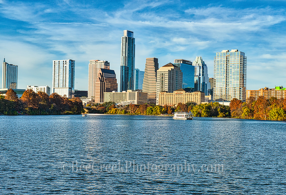 This is a view of the Austin skyline from across Lady bird Lake, you can see the capital Cruise boat as it meanders down the lake full of toursit. The Austin cityscape is a nice one with all the tallest building all along the lake and the view can be enjoyed by those on the hike and bike trails that run around the lake.