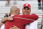 Washington State head football coach, Paul Wulff (hat), gets a congratulatory hug from linebackers coach, Travis Niekamp, after the Cougars thrilling 30-27 overtime victory over SMU at Martin Stadium in Pullman, Washington, on September 19, 2009.
