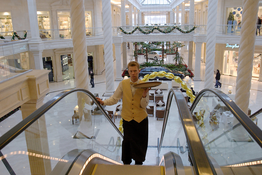 Moscow, Russia, 04/01/2004..Cafe waiter at the luxurious but largely deserted Crocus City shopping mall.