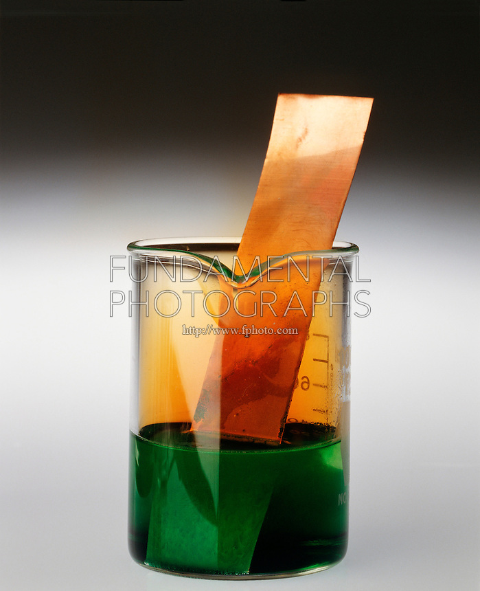 COPPER METAL REACTS WITH NITRIC ACID<br /> Copper Metal In A Beaker Of Nitric Acid<br /> Oxidation of copper metal by nitric acid produces nitric oxide (NO) gas which is immediately oxidized in air to form brown nitrogen dioxide (NO2) gas. The copper atoms lose two electrons to form Cu2+ ions which give a blue color in water.