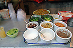 Asia, China, Chongqing. Selection of condiments at a local street market in the city of Chongqing.