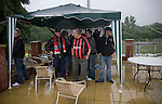 Supporters of Irish club Bohemians taking shelter from the rain under a gazebo outside Park Hall Stadium, Oswestry before their team's Champions League 2nd qualifying round 2nd leg game away to The New Saints. Despite leading 1-0 from the first leg, the Dublin club went out following their 4-0 defeat by the Welsh champions. The match was the first-ever Champions League match in the UK played on an artificial pitch and was staged at the Welsh Premier League's ground which was located over the border in England.