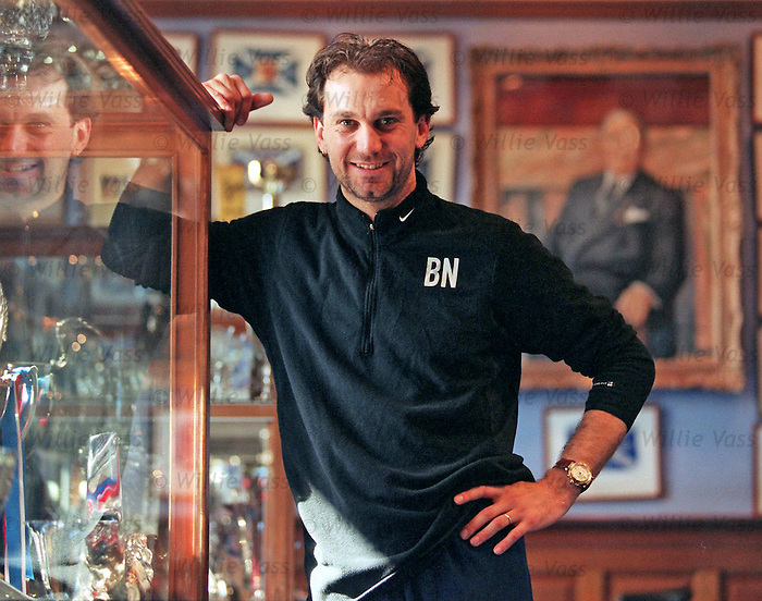 French goalkeeper Lionel Charbonnier eyes up the prizes in the Ibrox trophy room during his stay at Rangers between 1998-2001