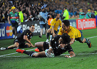 All Blacks' Ma'a Nonu scores in the tackle of Anthony Faingaa during the All Blacks v Australia semifinal match of the 2011 IRB Rugby World Cup at Eden Park, Auckland, New Zealand on Saturday, 16 October 2011. Photo: Dave Lintott / lintottphoto.co.nz
