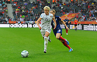 Megan Rapinoe (l) of team USA and Laure Lepailleur of team France during the FIFA Women's World Cup at the FIFA Stadium in Moenchengladbach, Germany on July 13th, 2011.