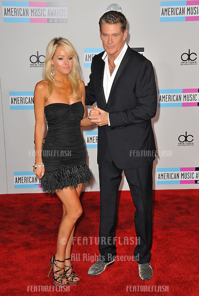 David Hasselhoff & girlfriend arriving at the 2011 American Music Awards at the Nokia Theatre, L.A. Live in downtown Los Angeles..November 20, 2011  Los Angeles, CA.Picture: Paul Smith / Featureflash