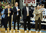30 January 2016: UNC head coach Roy Williams (right) with (from right) Steve Robinson, C.B. McGrath, and Brad Frederick wear sneakers with gold laces as part of the Coaches vs. Cancer game. The University of North Carolina Tar Heels hosted the Boston College Eagles at the Dean E. Smith Center in Chapel Hill, North Carolina in a 2015-16 NCAA Division I Men's Basketball game. UNC won the game 89-62.
