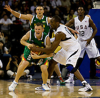 US guard (10) Kobe Bryant fouls Lithuania guard (4) Rimantas Kaukenas while playing at the Cotai Arena inside the Venetian Macau Resort and Hotel.  The US defeated Lithuania, 120-84.