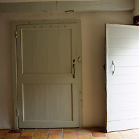 An extra-wide old farmhouse door has been given a modern twist with the use of calligraphic lettering