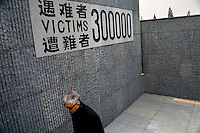 "A man walks among the sculptures in the grounds of the Memorial Hall of the Nanjing Massacre in Nanjing, China, on Thursday, Dec. 13, 2007. After two years of renovations, the Memorial Hall of the Nanjing Massacre reopened to the public on Dec. 13, 2007, the 70th anniversary of the 6-week massacre by Japanese troops that started Dec. 13, 1937 and claimed more than 300,000 lives.  The commemoration comes amid renewed controversy about the accuracy of historical accounts of the massacre.  The massacre is also known as ""The Rape of Nanking."""