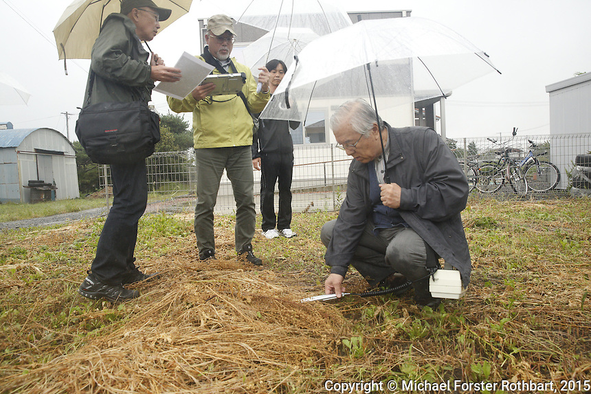 Nuclear scientist Ikuro Anzai and his dosimetry team measure radiation levels near Torikawa Nursery School in Fukushima City, and then report their findings to school director Miyoko Sato. Full caption to come.<br /> <br /> &copy; Michael Forster Rothbart Photography<br /> www.mfrphoto.com &bull; 607-267-4893<br /> 34 Spruce St, Oneonta, NY 13820<br /> 86 Three Mile Pond Rd, Vassalboro, ME 04989<br /> info@mfrphoto.com<br /> Photo by: Michael Forster Rothbart<br /> Date:  9/25/2015<br /> File#:  Canon &mdash; Canon EOS 5D Mark III digital camera frame A15782