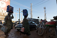 Arrival at the market nearby the football stadium, Nakasero, central Kampala. The floodlights have been used as supports for mobile base station antenae.