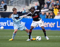 Oriol Rosell (20) of Sporting Kansas City fights for the ball with Keon Daniel (26) of  the Philadelphia Union during the game at PPL Park in Chester, PA.  Kansas City defeated Philadelphia, 3-1.