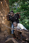 Simon Peter Gamana (front) and Charles Gorden patrol the forest near their village of Riimenze, in Southern Sudan's Western Equatoria State, on the look out for the Lord's Resistance Army, which has displaced tens of thousands in recent months along the border area. Many believe the northern Sudan government is behind the attacks in its desire to destabilize the south in the period leading to a January 2011 referendum on secession. NOTE: In July 2011 Southern Sudan became the independent country of South Sudan.