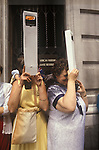 Royal Wedding of Prince Charles ands Lady Diana Spencer, two women using sourvenir periscopes to look over the crowd of to view the ceremony  London Uk