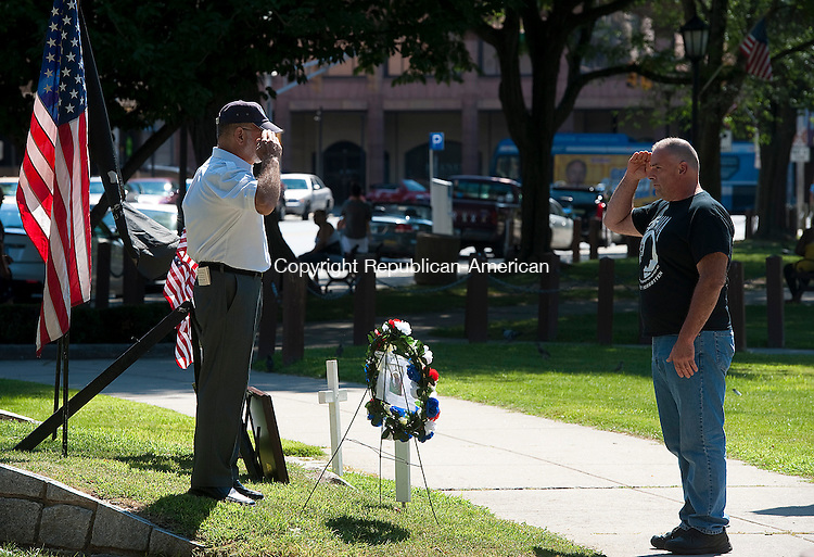WATERBURY, CT--- -072515JS04--David George, right, salutes Cosimo &ldquo;Doc&rdquo; D&rsquo;Occhio, a member of the Waterbury Veterans Memorial Committee, left,  after placing a wreath at the memorial for POW/MIA's during the 18th Annual Korean War Veterans Remembrance Day ceremony Saturday on the Waterbury Green. <br /> Jim Shannon Republican-American