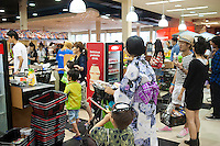 Shoppers at Mitsuwa asian market during their Obon summer festival in Edgewater, NJ on Saturday. August 18, 2012. The supermarket chain of nine stores located across the country sells Japanese food and goods.  The company holds a yearly summer festival inviting customers to their facilities to enjoy traditional food and partake of the many sales offered on their merchandise. (© Richard B. Levine)