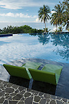 Anda, Bohol, Philippines; early morning reflections of a pair of chairs in the infinity pool at Amun Ini Resort