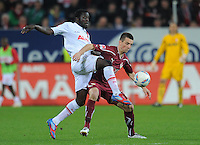 FUSSBALL   1. BUNDESLIGA  SAISON 2011/2012   30. Spieltag FC Augsburg - VfB Stuttgart           10.04.2012 Gibril Sankoh (li, FC Augsburg) gegen Vedad Ibisevic (VfB Stuttgart)