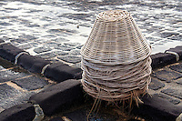Baskets for collecting salt at a salt pan.