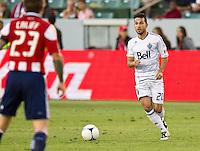 CARSON, CA - July 7, 2012: Vancouver Whitecaps midfielder Davide Chiumiento (20) during the Chivas USA vs Vancouver Whitecaps FC match at the Home Depot Center in Carson, California. Final score Vancouver Whitecaps FC 0, Chivas USA 0.